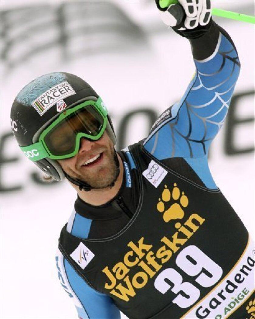 Steven Nyman, of the United States, celebrates after winning an alpine ski, men's World Cup downhill, in Val Gardena, Italy, Saturday, Dec. 15, 2012. (AP Photo/Alessandro Trovati)