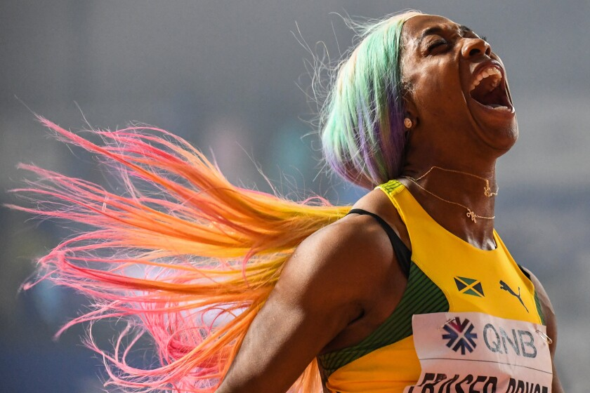 Jamaica's Shelly-Ann Fraser-Pryce celebrates after winning the women's 100 meters.
