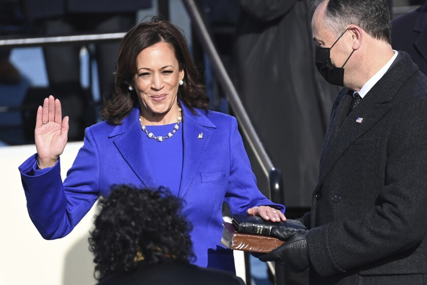 Kamala Harris is sworn in as vice president by Supreme Court Justice Sonia Sotomayor.