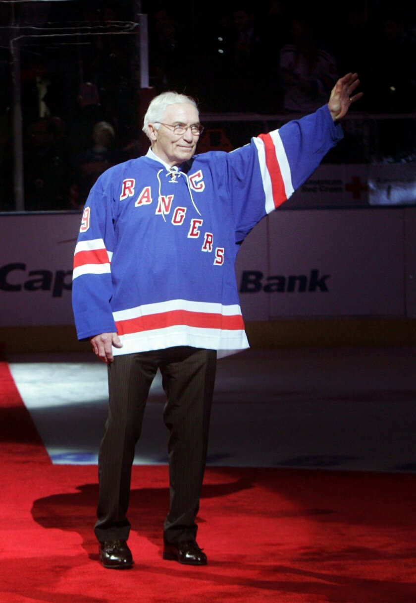 FILE - In this Feb. 22, 2009, file photo, former New York Rangers' Andy Bathgate waves to fans after his number was retired during a pregame ceremony before an NHL hockey game between the Rangers and the Toronto Maple Leafs at Madison Square Garden in New York. Bathgate, a Hall of Fame winger and one of the most prolific scorers of his day, died the Hockey Hall of Fame and by the New York Rangers confirmed, Friday, Feb. 26, 2016. He was 83. (AP Photo/Seth Wenig, File)