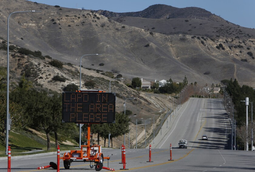 A sign in Porter Ranch alerts residents to call 911 to report crime in the area. More than 2,000 people have been placed in temporary housing because of a gas leak at the nearby Aliso Canyon storage facility.