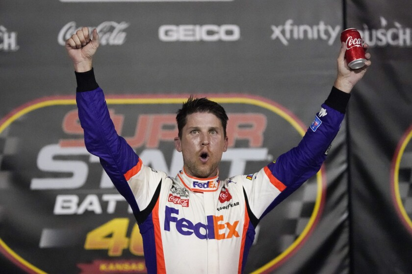 Denny Hamlin celebrates after winning a NASCAR Cup Series auto race at Kansas Speedway on Thursday night.