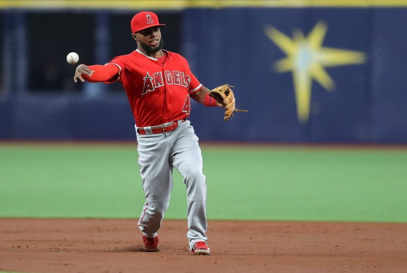 Angels infielder Luis Rengifo throws to first base.