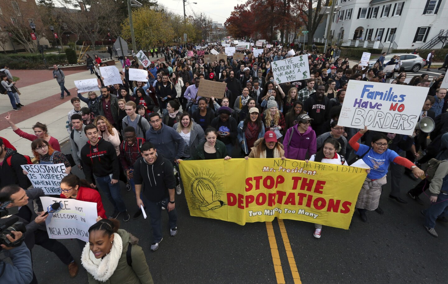 Hundreds of Rutgers University students march to protest President-elect Donald Trump's policies and to ask school officials to denounce his plans on Wednesday, Nov. 16, 2016, in New Brunswick, N.J.