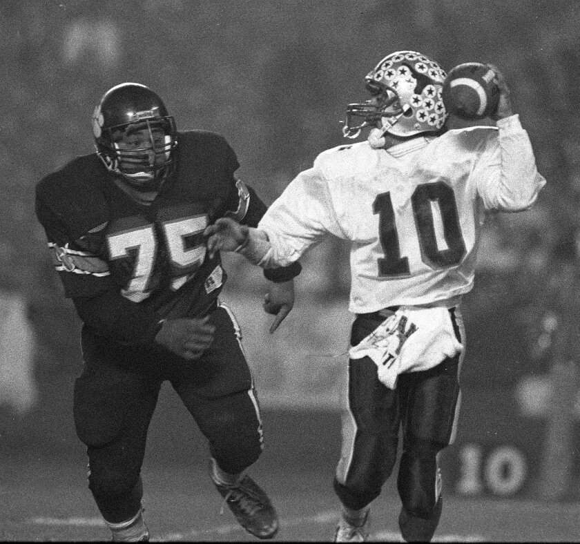 Dave Roberts (#10) was distinguishable when handling the football for Rancho Buena Vista High. The Longhorns won the CIF championship in 1989 with Roberts handing off or pitching to running backs Markeith Ross and O.J. Hall.