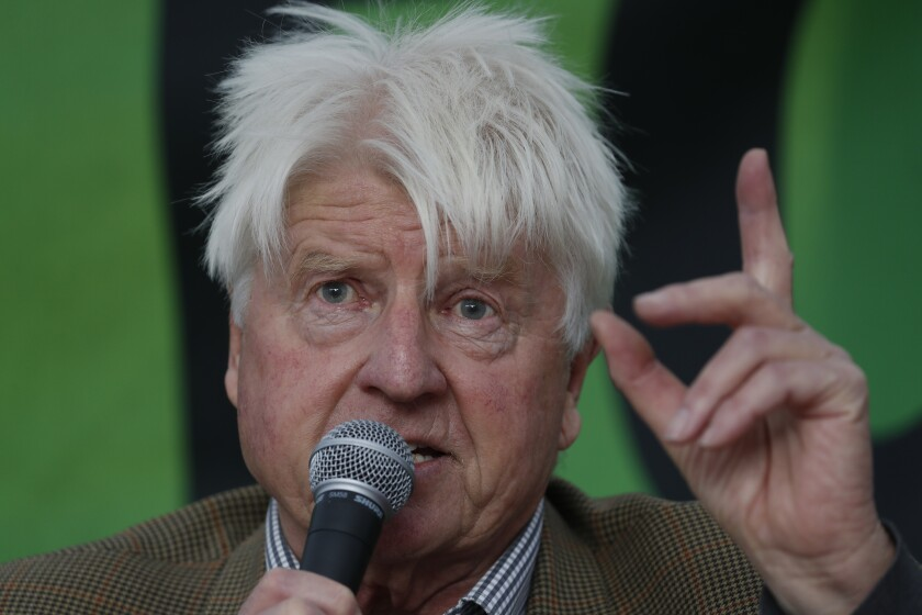 Stanley Johnson, father of the British Prime Minister Boris Johnson, speaks at an Extinction Rebellion panel on climate change in Trafalgar Square, on the third day of ongoing demonstrations in London, Wednesday, Oct. 9, 2019. Police are reporting they have arrested more than 500 people since the start of two weeks of protests as the Extinction Rebellion group attempts to draw attention to global warming .(AP Photo/Alastair Grant)