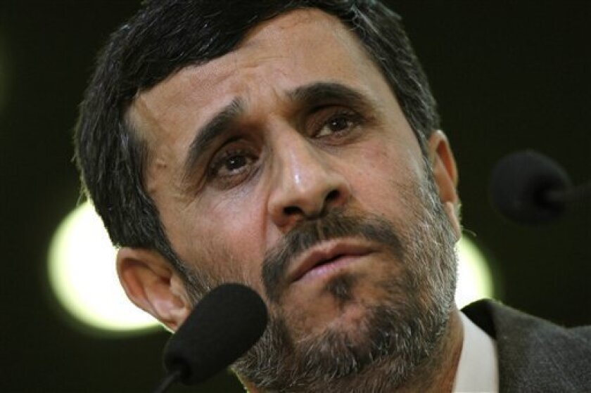 FILE - In this Nov. 23, 2009 file photo, Iran's President Mahmoud Ahmadinejad speaks during a meeting with Brazil's President Luiz Inacio Lula da Silva in Brasilia. Ahmadinejad said Tuesday, Dec. 2, 2009 that Iran will now enrich its uranium to an even higher level, defying a U.N. call to halt the process due to fears over the country's nuclear program. (AP Photo/Andre Penner, File)
