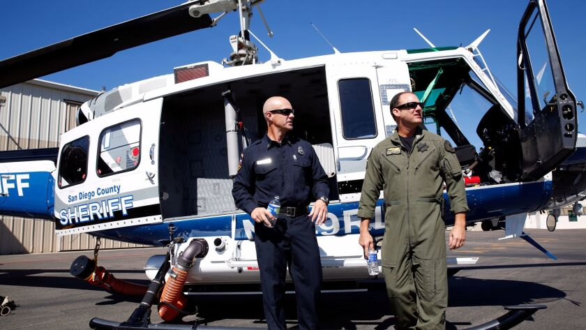 Cal Fire Capt. Dave LaMora (left) and San Diego County Sheriff's Department ASTREA (Aerial Support t