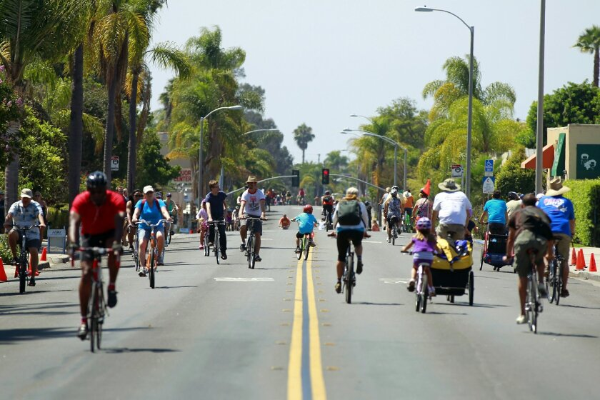 Bicyclists ride along 30th Street in North Park during the first CicloSDias event.