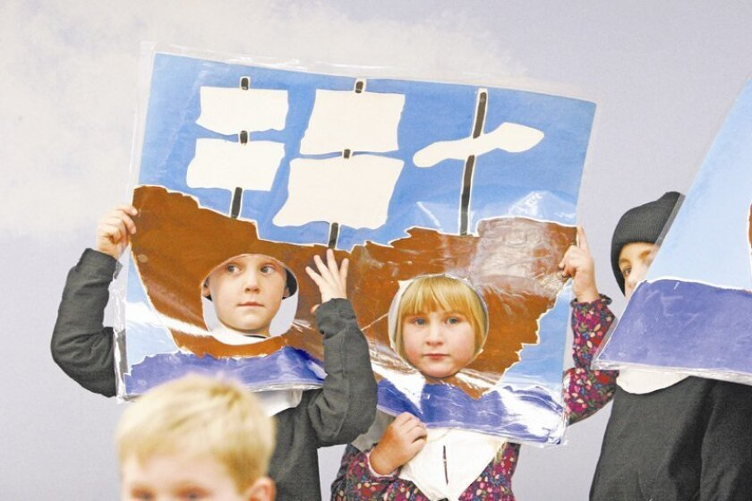 Kindergartners Wyatt Cargel (left) and Sierra Mellinger played the role of the Mayflower during a retelling of the history of the first Thanksgiving at Alpine's Creekside Early Learning Center.