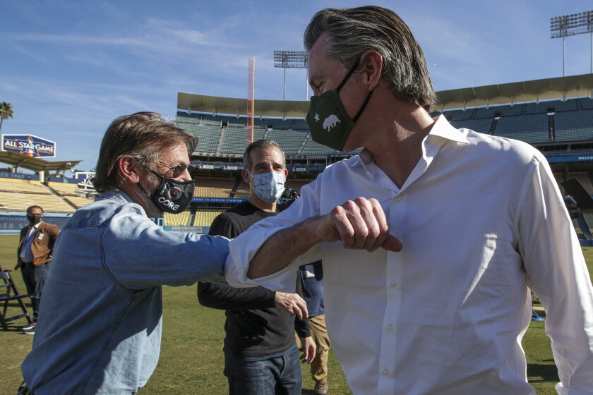 Actor Sean Penn with L.A. Mayor Eric Garcetti and Governor Gavin Newsom at the Dodger Stadium vaccination site.