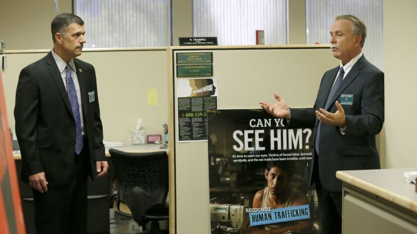 Officials Tuesday announced that dozens of victims were rescued in a multi-agency human trafficking operation, which was overseen by Kent Wegener, captain of the L.A. County Sheriff's Human Trafficking Bureau. Wegener, right, is pictured here in a 2016 file photo.