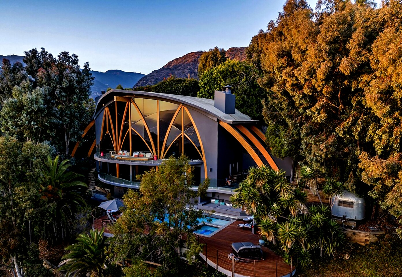 Called Ravenseye, the striking home overlooking Las Flores Beach in Malibu was built for Jerome Lawrence after the playwright's previous home was destroyed by wildfire. Harry Gesner handled the design of the three-bedroom home, which features expanses of glass, gothic arches and mosaic stone floors. The noted Malibu architect would return to remodel the home for a later owner. Listed for $14 million, the modernist residence takes in commanding ocean views. Also on the grounds are a swimming pool and a vintage Airstream trailer that serves as a guesthouse.