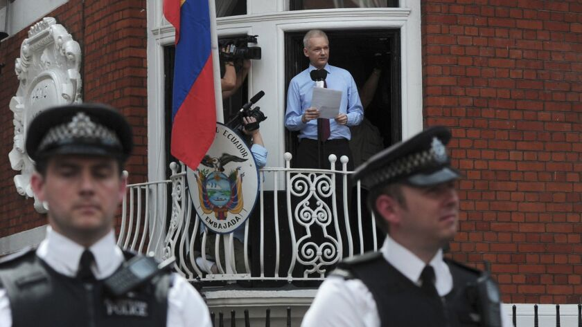 Wikileaks founder Julian Assange addresses the media and his supporters from the balcony of the Ecua