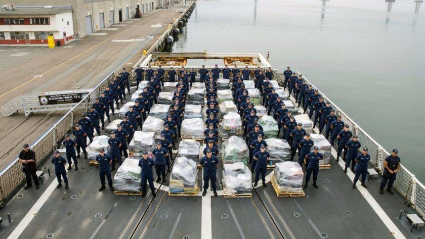 In this photo provided by the U.S. Coast Guard the crew of the Coast Guard Cutter Waesche, prepare t