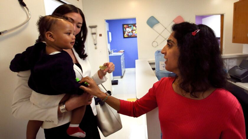 LOS ANGELES, CA-FEBRUARY 6, 2015: Dr. Monica Asnani, right, says goodbye to Kristian Richard, 1, be