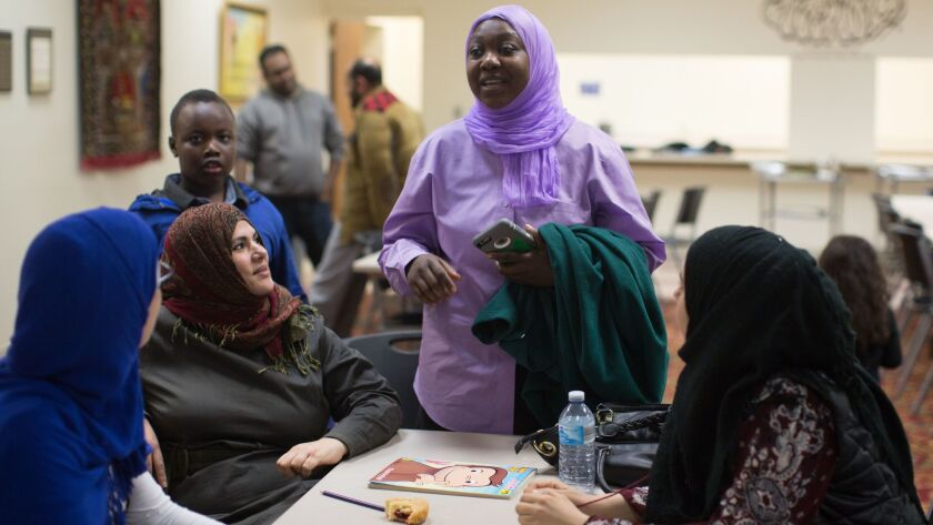 Asma Ali speaks with other women in Cedar Rapids, Iowa, on Nov. 12, 2016, during a discussion of issues related to Donald Trump's election.