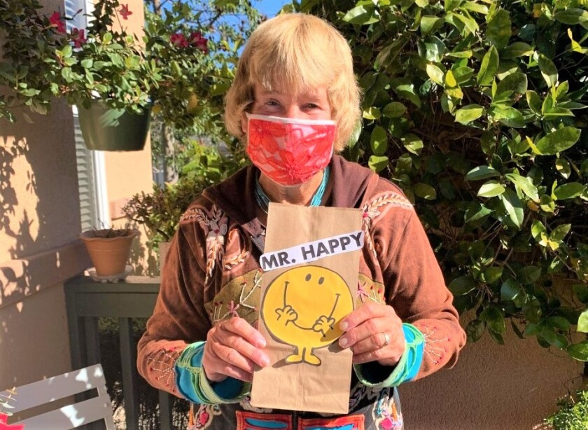 """Carol Dykstra never fails to leave a treat, such as a protein bar, for her gardner. She put one in this """"Mr. Happy"""" bag."""