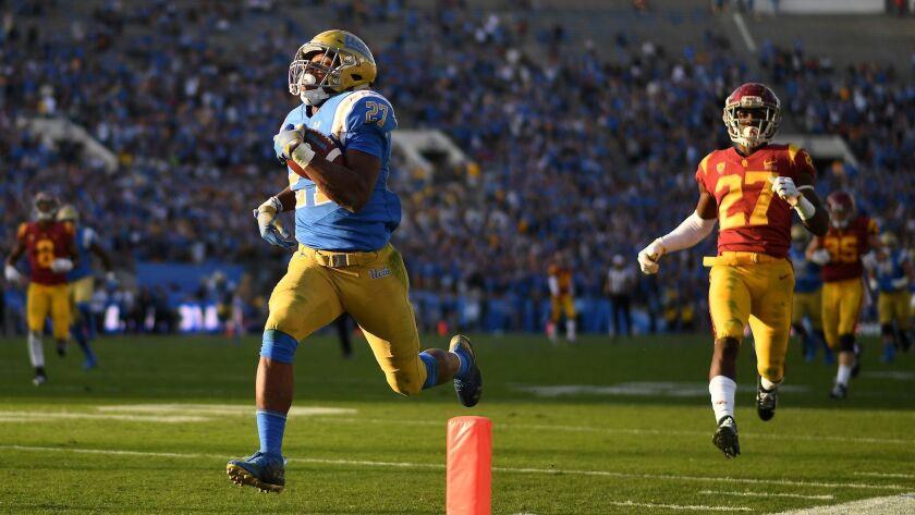 PASADENA, CALIFORNIA OCTOBER 17, 2018-UCLA running Joshua Kelley scores a 55-yard touchdown in fornt