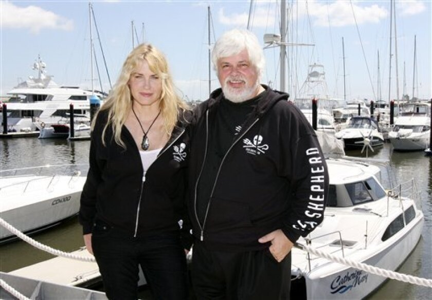 """U.S. actress Daryl Hannah and Captain Paul Watson from the U.S.-based Sea Shepherd Conservation Society are pictured before leaving Brisbane, Australia on a voyage to disrupt Japanese whalers in Antarctic waters, Wednesday, Dec. 3, 2008. Hannah, an environmental activist, who will sail on the Sea Shepherd's flagship, """"Steve Irwin,"""" said the whaling industry could be shut down if conservationists worked together and governments enforced anti-whaling laws. (AP Photo/Tertius Pickard)"""