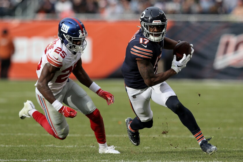 Chicago Bears wide receiver Anthony Miller runs with the ball while being chased by Giants cornerback Corey Ballentine.