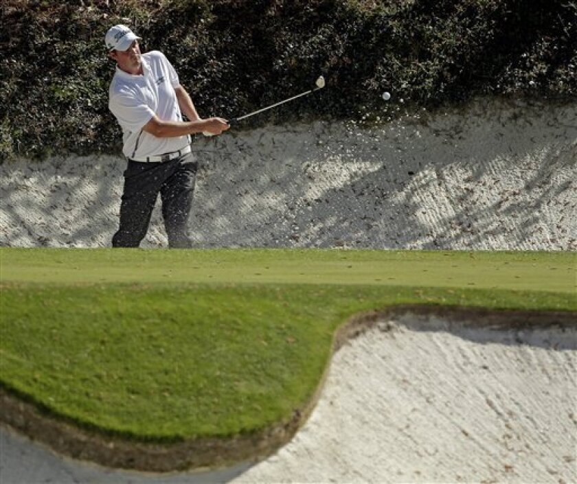 Marc Leishman, of Australia, chips out of a bunker on the 12th hole during the second round of the Masters golf tournament Friday, April 12, 2013, in Augusta, Ga. (AP Photo/Charlie Riedel)