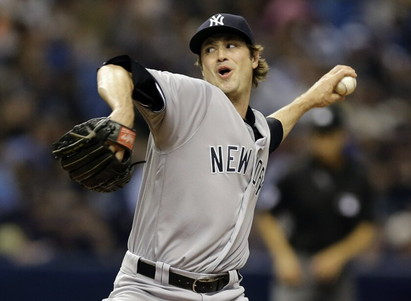 FILE - In a Friday, May 27, 2016 file photo, New York Yankees relief pitcher Andrew Miller delivers to the Tampa Bay Rays during the eighth inning of a baseball game in St. Petersburg, Fla. A person familiar with the trade says Sunday, July 31, 2016, that the Cleveland Indians have acquired left-ha