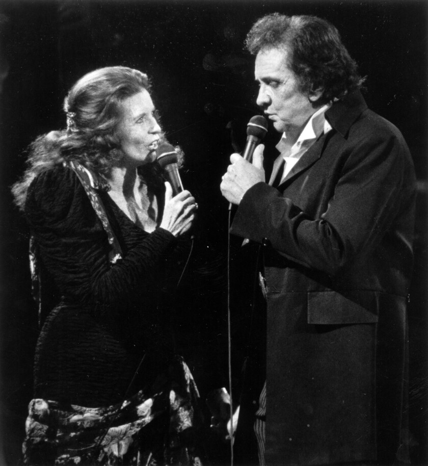 June Carter Cash sings Johnny Cash, during a 1991 performance at the Celebrity Theater in Anaheim.