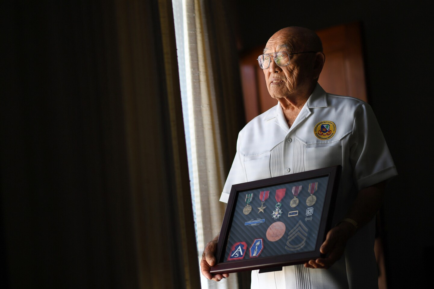 Tokuji Yoshihashi, 94, is photographed with his collection of medals at home in San Gabriel. Exactly 75 years ago Sunday, President Franklin D. Roosevelt signed Executive Order 9066, which paved the way for the incarceration of Yoshihashi and 120,000 other Japanese Americans