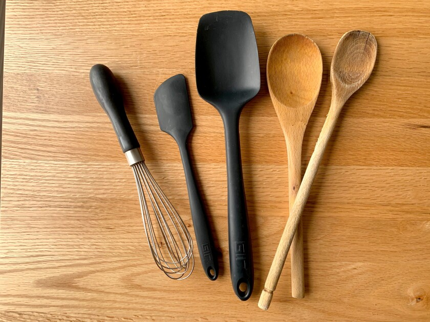 Whisks, silicone spatulas and wooden spoons.