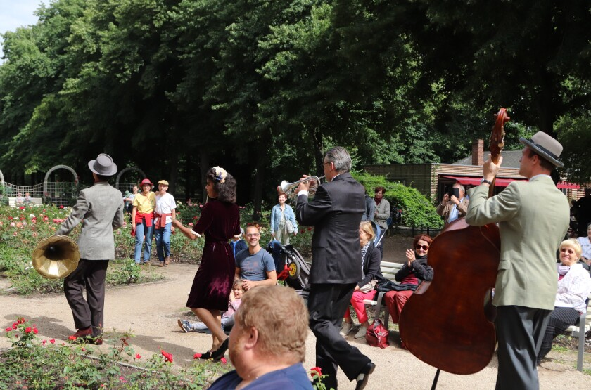 The Swingin' Hermlins giving a concert in a Berlin park.