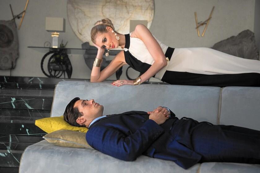 """Henry Cavill as Solo and Elizabeth Debicki as Victoria in """"The Man From U.N.C.L.E."""""""