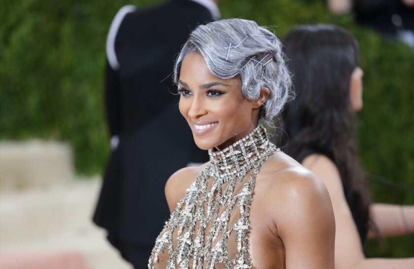 Ciara arrives on the red carpet for the 2016 Met Gala in New York with the metallic and silver look that dominated the event.