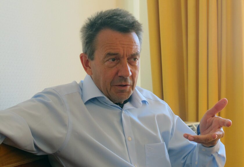 The president of the International Committee of the Red Cross, Peter Maurer, gestures during an interview with The Associated Press at the organization's headquarters in Geneva, Switzerland, on Wednesday Aug. 19, 2015. ( AP Photo/Frank Jordans)
