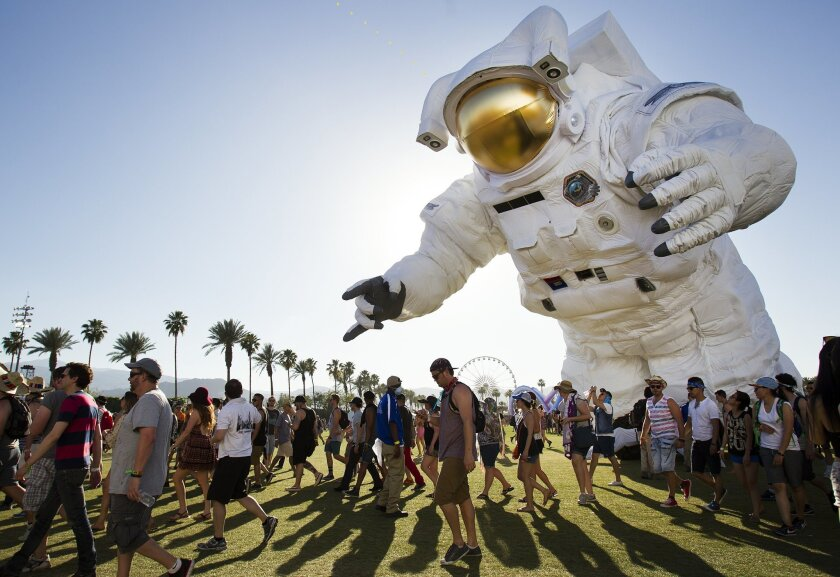 "On the first day of the 2014 Coachella Valley Music and Arts Festival, a sold-out crowd encountered a moving art piece called ""Escape Velocity,"" created by Poetic Kinetics. The astronaut-inspired figure was 36 feet tall, 57 feet long and 40 feet wide."