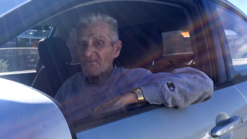 Doyle MacCree, 84, listens to Rush Limbaugh's national radio show in the parking lot of a Goodyear, Ariz., mall.