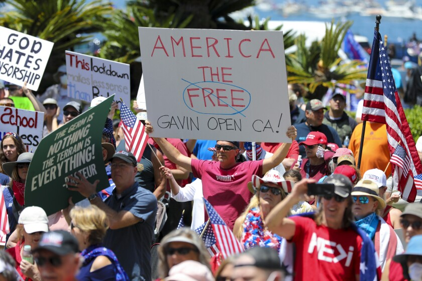 Demonstrators gathered at a noon rally in front of the San Diego County administration building on Saturday to demand that elected leaders open California.