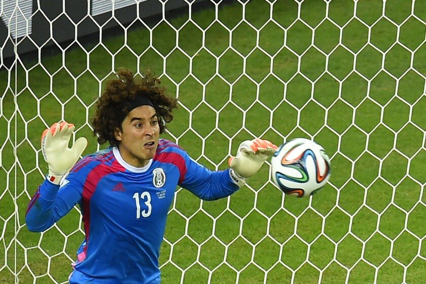 Mexico's goalkeeper Guillermo Ochoa saves an attempt at goal during a game against Brazil on Tuesday.