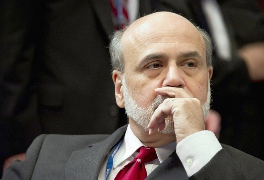 U.S. Federal Reserve Chairman Ben S. Bernanke is seen at the International Monetary and Financial Committee Meeting in Tokyo earlier this month. The Fed announced Wednesday that it will keep short-term interest rates unchanged through mid-2015.