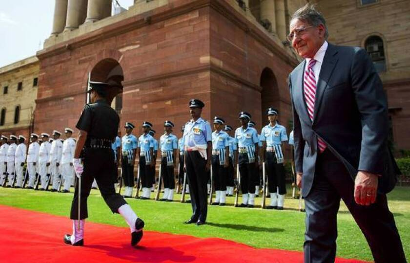 U.S. Defense Secretary Leon E. Panetta, right, inspects Indian troops during a welcoming ceremony at the Defense Ministry in New Delhi.