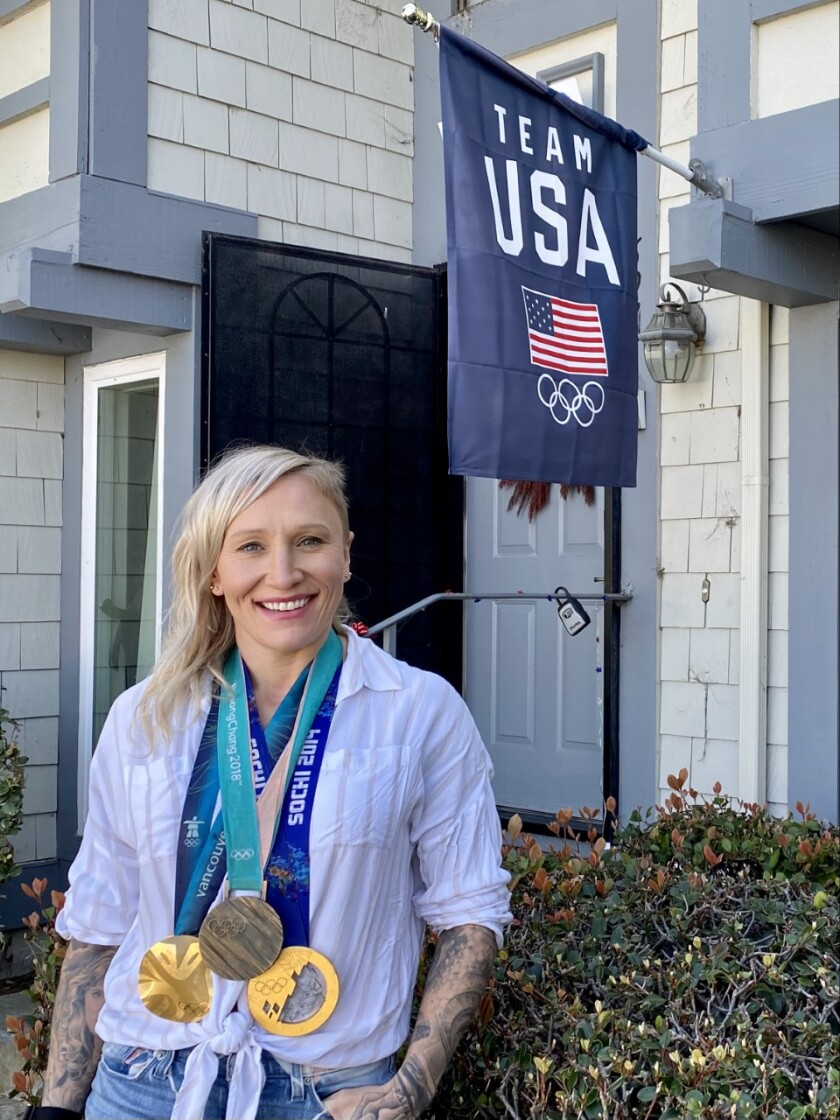 World bobsled champion Kaillie Humphries shows off some of her medals in front of her Carlsbad townhome.