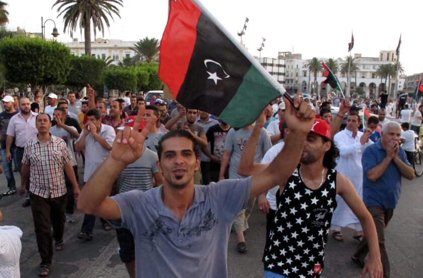 """Libyan protesters rally in Tripoli, the capital. More countries moved to evacuate their citizens from Libya, where the fighting between rival militias is escalating. Islamist militants have declared an """"Islamic emirate"""" in Benghazi."""