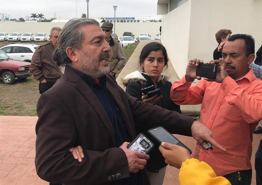 Jorge Fernandez and Adriana Gonzalez, parents of Jorge Fernandez Jr., speak with reporters. Fernandez Jr. was found guilty by a Mexican court of the 2017 murder of his wife, Spanish citizen Pilar Garrido. In Ciudad Victoria, Mexico. Jan. 10, 2019. EPA-EFE/Alfredo Martinez