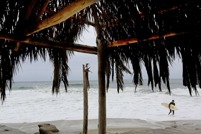 A surfer walks out of the water as seen from The Shack at Windansea Beach in La Jolla on Wednesday, May 22, 2013.(Photo by Sandy Huffaker)