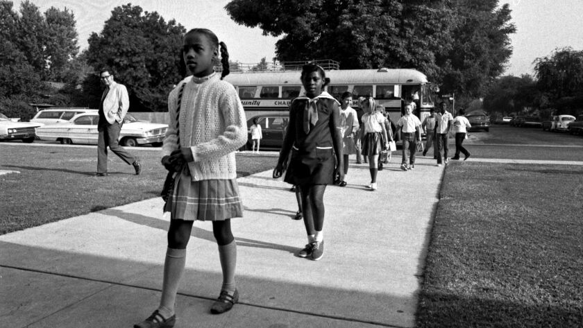 First African American students arrive by bus to attend Plymouth Elementary School in Monrovia, Calif. 1970