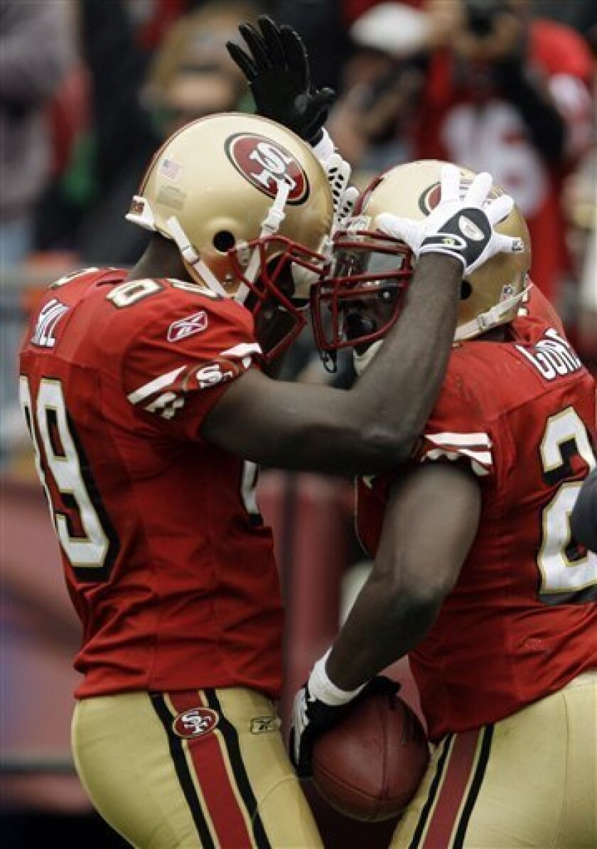 San Francisco 49ers' Frank Gore, right, celebrates his touchdown against the New York Jets with teammate Jason Hill (89) in the second quarter of an NFL football game Sunday, Dec. 7, 2008, in San Francisco. (AP Photo/Ben Margot)