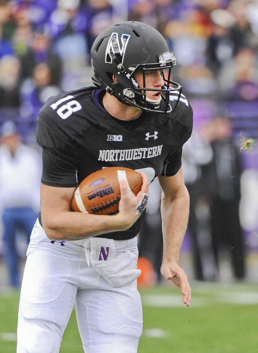 Northwestern quarterback Clayton Thorson (18) runs against Penn State during the first quarter of an NCAA college football game in Evanston, Ill.,  Saturday, Nov. 7, 2015. (AP Photo/Matt Marton)