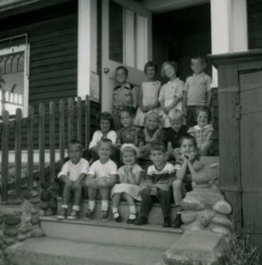 This undated class photo was taken on steps of a west entry to Wisteria Cottage. The steps were later removed and the door in-filled at an unknown date. Courtesy