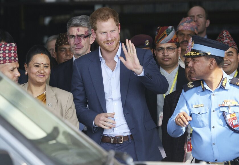 British Prince Harry arrives in Tribhuwan International Airport in Kathmandu, Nepal, Saturday, March 19, 2016. When Britain's Prince Harry visits Nepal this weekend, ordinary people hope his tour of earthquake-hit areas will draw attention to the country's struggle to recover from last year's disaster. (AP Photo/Niranjan Shrestha)