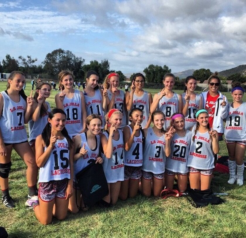 La Jolla seventh- and eighth-graders with coach Kitty Cullen after going undefeated and winning the spring Division A championship. Courtesy